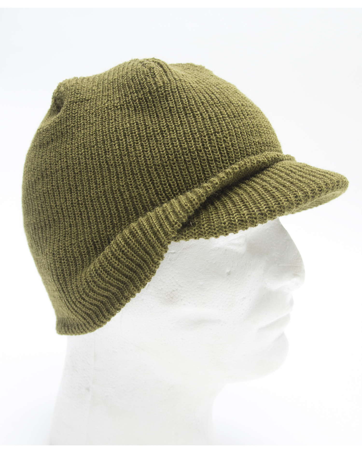257e90dbd3c M1941 wool knit cap with short visor designed to be worn under the steel  helmet. Commonly known as the